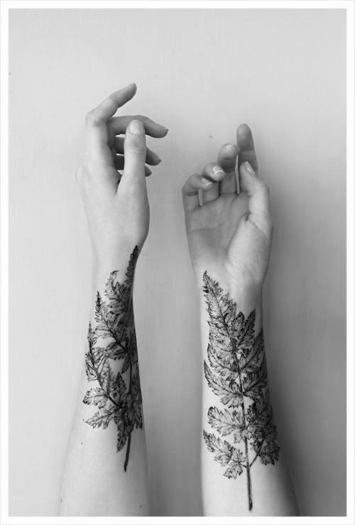 Realistic-hand-leaf-tattoo